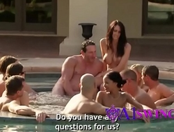 Young swingers swimming in pool